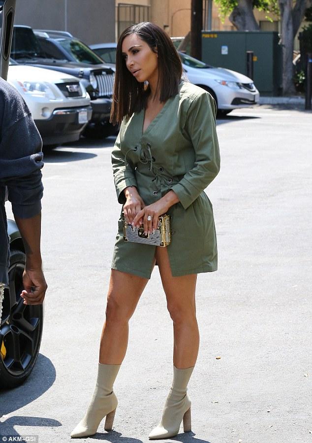 Kim kardashian sports new short hair cut out with kanye